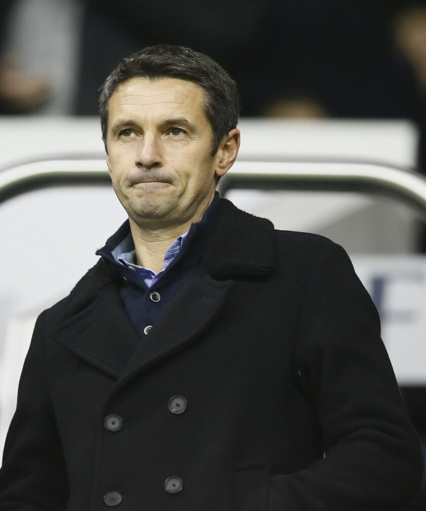 Aston Villa's newly appointed manager Remi Garde in the stands ahead of the English Premiership soccer match between Tottenham Hotspur and Aston Villa at White Hart Lane stadium in London, Monday, Nov. 2, 2015. (AP Photo/Kirsty Wigglesworth)