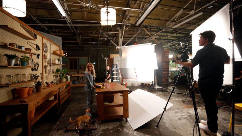 SANTA MONICA, CA -- OCTOBER 31, 2017 -- Woodworker Aleksandra Zee and her dog Jack are filmed by Pet