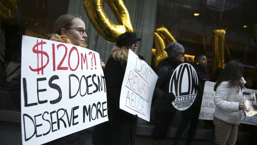 Protesters outside the CBS shareholders' meeting in New York on Tuesday demand that $120 million in severance be withheld from former CEO Les Moonves.