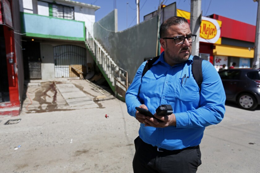 Isai Lara Bermudez, an investigative reporter for Zeta, covers a homicide in the El Refugio housing