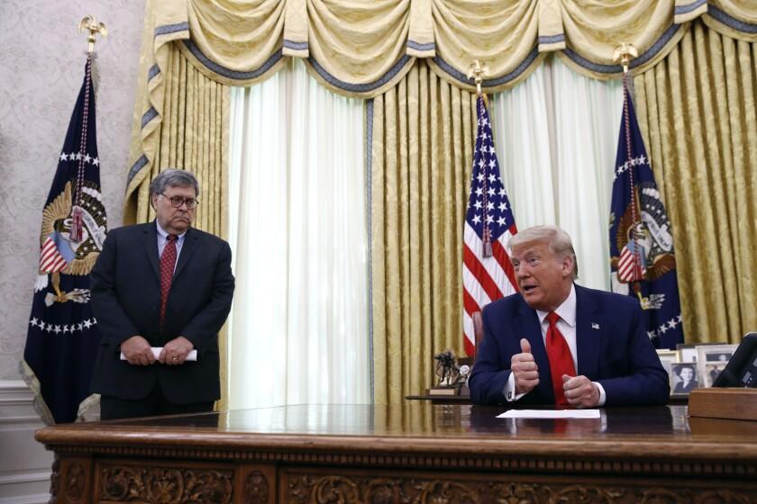 President Donald Trump speaks alongside Attorney General William Barr.