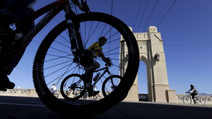 FILE - In this Oct. 9, 2011, file photo, bicyclists make their way along the Fourth Street Bridge ne