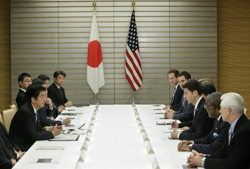 Rep. Paul Ryan, third from right, speaking with Japanese Prime Minister Shinzo Abe about the Trans-Pacific Partnership and other issues at Abe's official residence in Tokyo last month.