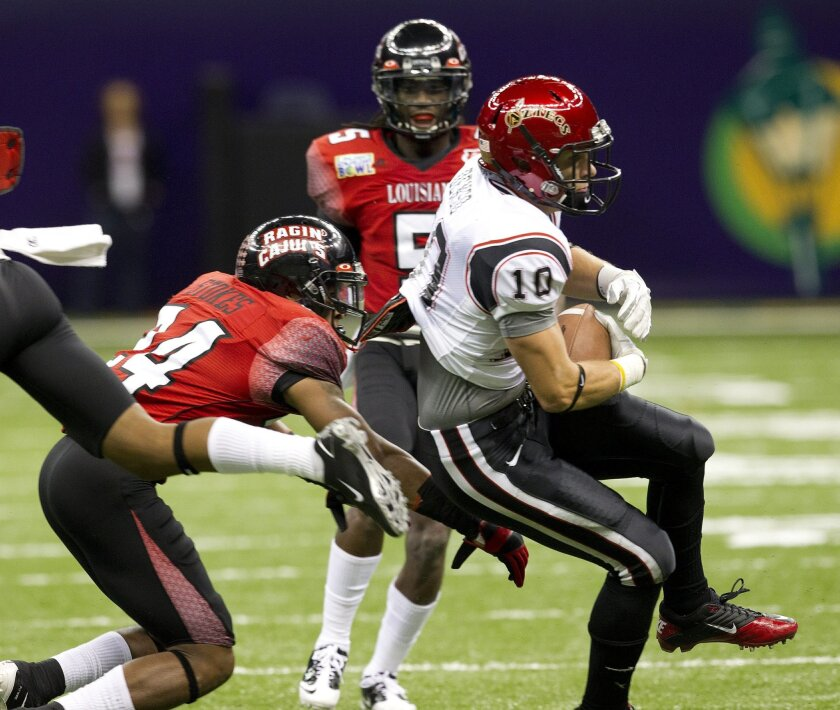 Dylan Denso catches a long pass and run in the lst quarter to set up San Diego's only lst half score during SDSU's game against Louisiana-Lafayette at the New Orleans Bowl in New Orleans, La.