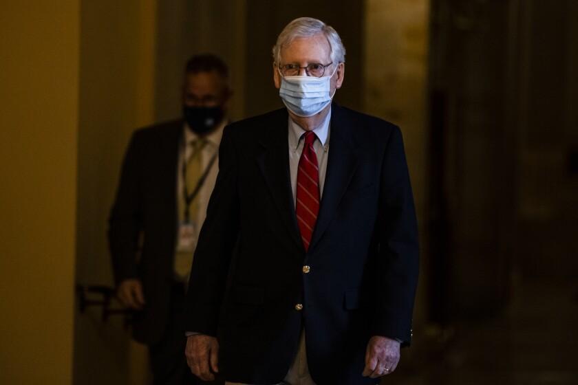 Senate Minority Leader Sen. Charles E. Schumer walks past reporters on Capitol Hill in Washington.