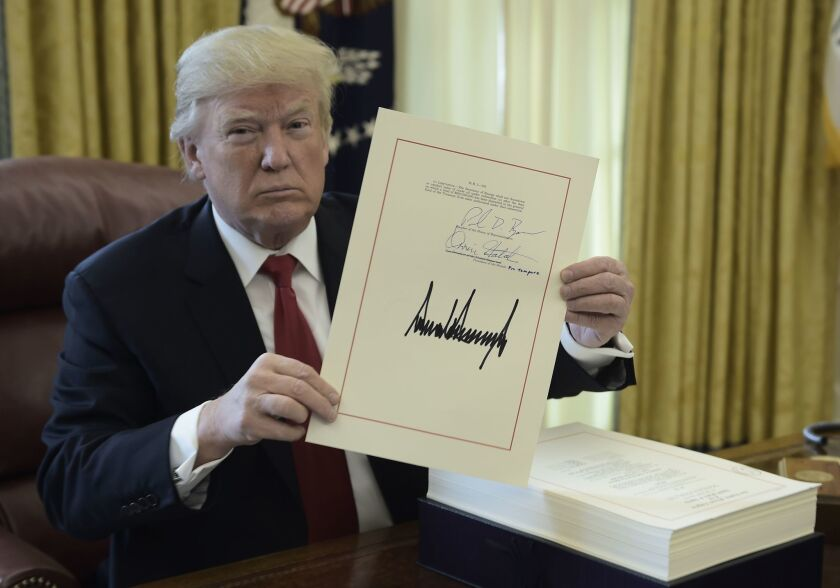 President Trump at the signing of the tax bill on Dec. 22, 2017.
