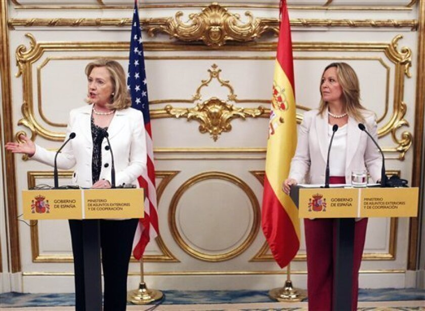 US Secretary of State Hillary Rodham Clinton, left, gestures during the press conference with Spain's Foreign Minister Trinidad Jimenez, right, in Madrid Saturday July 2, 2011. Clinton is visiting Madrid and will later meet Spain's King Juan Carlos and Prime Minister Jose Luis Rodriguez Zapatero. (AP Photo/Andres Kudacki)