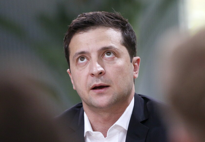 FILE - In this Oct. 10, 2019, file photo, Ukrainian President Volodymyr Zelenskiy speaks during talks with journalists in Kyiv, Ukraine. Zelenskiy travels to Paris on Monday, Dec. 9, for a summit meeting with the leaders of Russia, France and Germany. (AP Photo/Efrem Lukatsky, File)