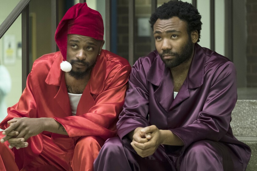 "This image released by FX shows Lakeith Stanfield, left, and Donald Glover in a scene from ""Atlanta."" The FX comedy created by and starring Glover will begin its pandemic-delayed production in the first half of 2021, FX Networks Chairman John Landgraf said Wednesday, Sept. 9, 2020. (Guy D'Alema/FX via AP)"