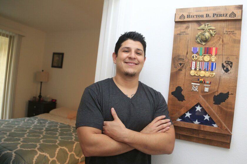 Marine Corps veteran Hector Perez stands inside his new Mission Valley apartment provided by Operation Homefront as part of the organization's Veterans Village program.