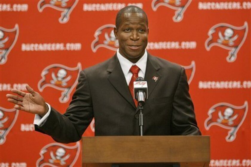 New Tampa Bay Buccaneers head coach Raheem Morris gestures as he is introduced to the media during a news conference Saturday afternoon Jan. 17, 2009 in Tampa, Fla. Morris replaces Jon Gruden, who was fired on Friday.(AP Photo/Chris O'Meara)