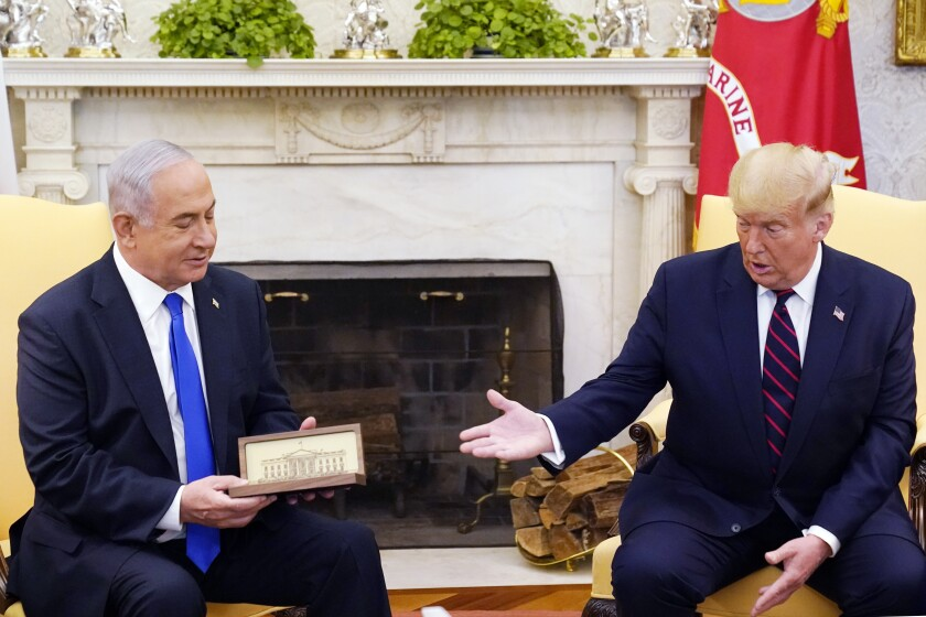 Benjamin Netanyahu and then-President Trump sit together in the Oval Office.