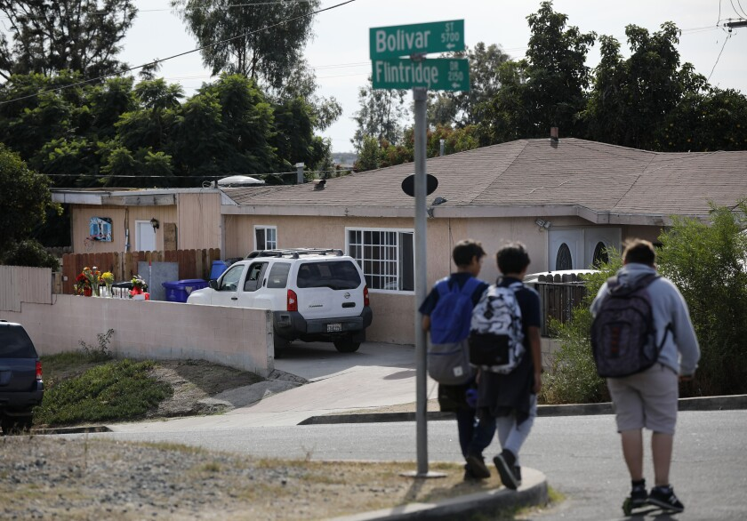 On Monday, boys walked near the Paradise Hills home where a deadly domestic shooting occurred Saturday. The father is suspected of killing his wife and their four children.