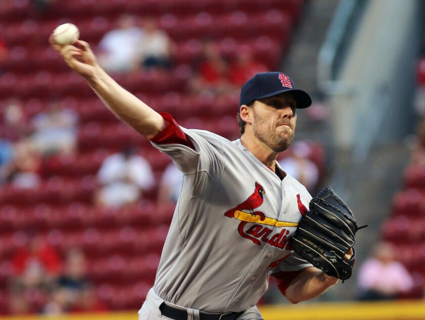 St. Louis Cardinals John Lackey pitches against the Cincinnati Reds in the first inning of their baseball game in Cincinnati, Wednesday Sept. 10, 2014. (AP Photo/Tom Uhlman)