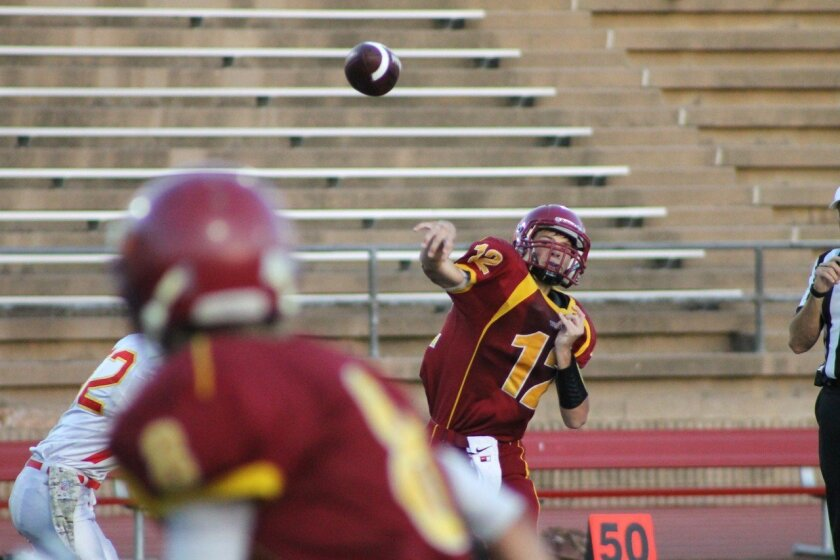 Quarterback Miles Hastings (12) unloads a pass. Photo by Morgan Schreiber