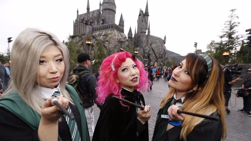 Diana Li, from left, Bebe Lee and Katie Mitchell enter the Wizarding World of Harry Potter at Universal Studios Hollywood on April 7, 2016.