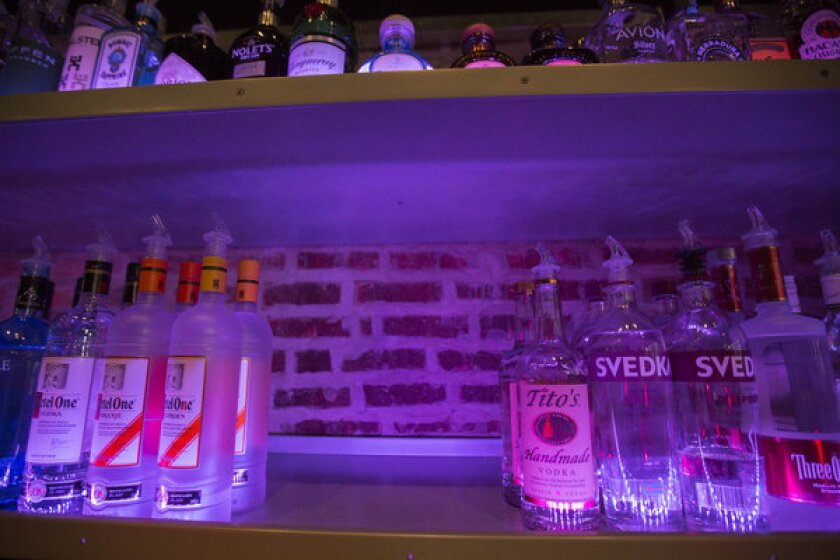 An empty space on a liquor shelf where Russian vodka used to be located at the Sidetrack, a gay bar on the north side of Chicago.