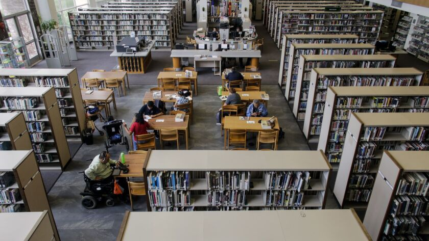 A Santa Ana library where study carrels were removed to discourage illegal activities like shooting drugs or sleeping hidden from public view.