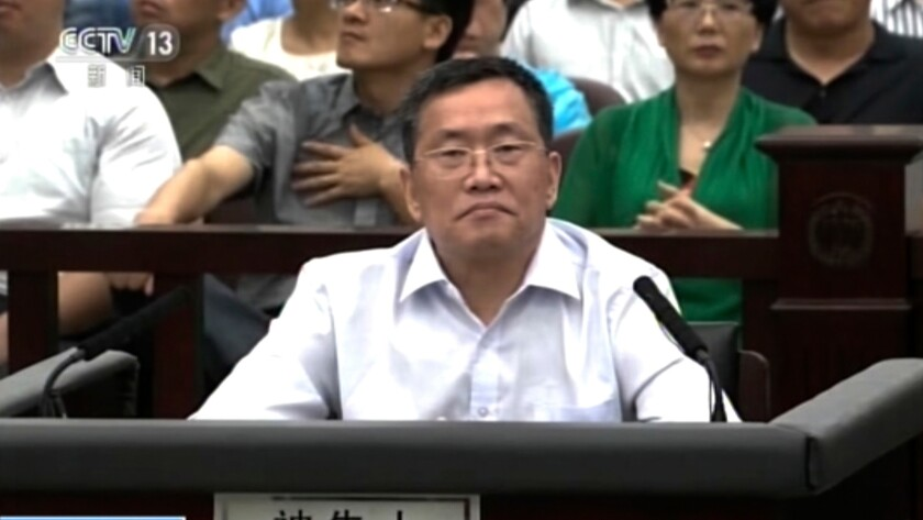 Zhou Shifeng sits for his trial at the No. 2 Intermediate People's Court in Tianjin.