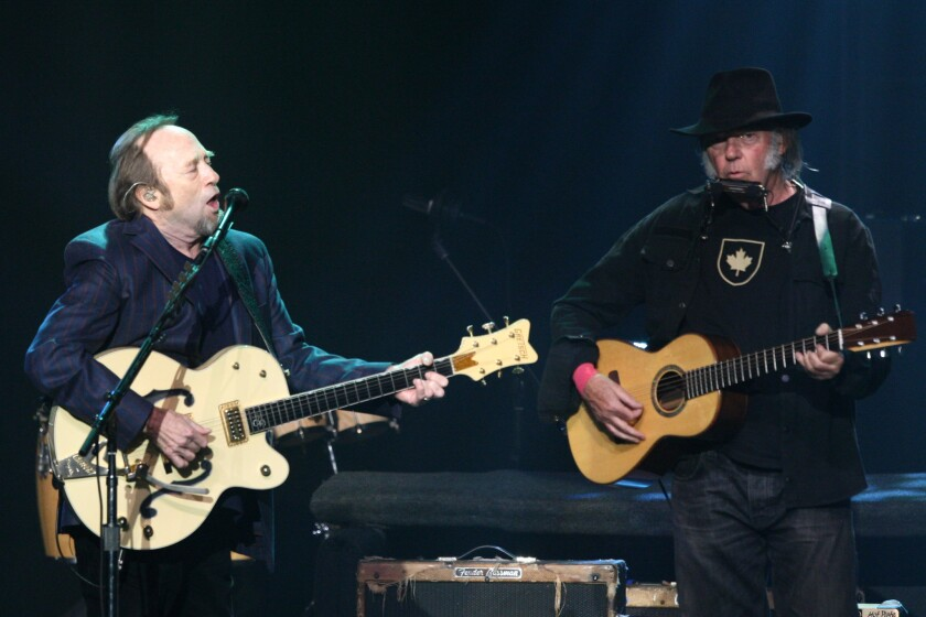 Stephen Stills, left, and Neil Young perform during the third Light Up the Blues Concert to benefit Autism Speaks on Saturday night at the Pantages Theatre in Hollywood.