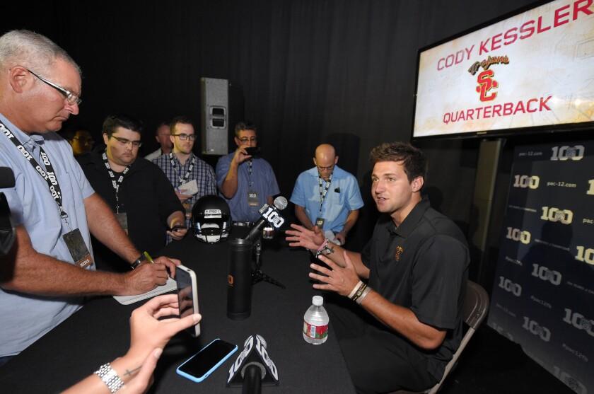 USC quarterback Cody Kessler speaks to reporters during Pac-12 Conference football media day at Warner Bros. Studios in Burbank.