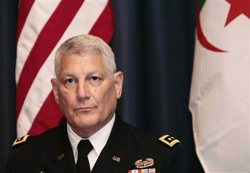 In this Thursday, Sept. 8, 2011 photo, Gen. Carter Ham, head of the U.S. African command, attends a conference on terrorism in the Sahara in Algiers, Algeria. A U.S. Army brigade will begin sending small teams into as many as 35 African nations in early 2013, part of an intensifying Pentagon effort