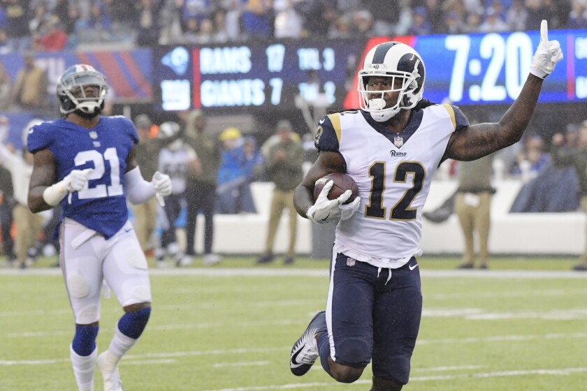 Rams wide receiver Sammy Watkins celebrates as he runs away from Giants safety Landon Collins for a 67-yard touchdown during the first half on Sunday.
