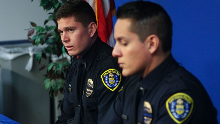 San Diego Police officers Tom McGrath (left) and Max Verduzco (right) spoke with the news media abou