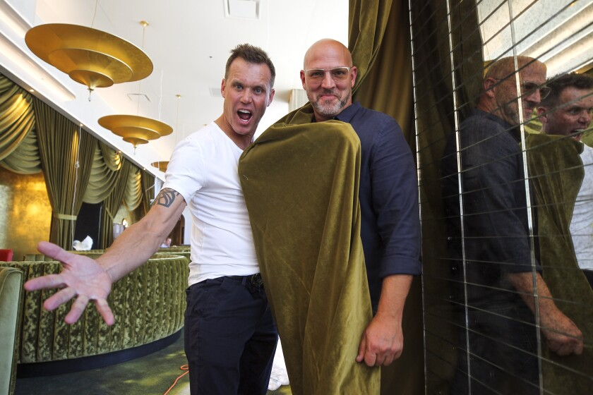 Chef Brian Malarkey (left) and partner Chris Puffer get animated about the opening of Animae, their swanky, pan-Asian new restaurant in downtown San Diego.