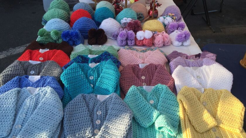 Crocheted sweaters, hats, boots and blankets by North Star Creations