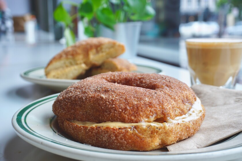 Through May 31, churro bagels with dulce de leche cream cheese are on the menu at Spill the Beans coffeehouse in the Gaslamp Quarter.
