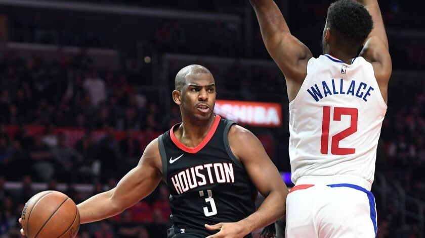 LOS ANGELES, CALIFORNIA JANUARY 1, 2018-Rockets Chris Paul gets off a pass in front of Clippers Tyro
