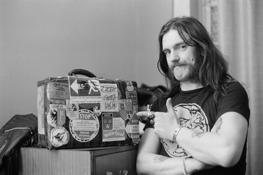 Lemmy Kilmister points to a tour case backstage at City Hall in Newcastle, England on March 22, 1982. The Motorhead frontman died on Monday, Dec. 28, 2015, at age 70.