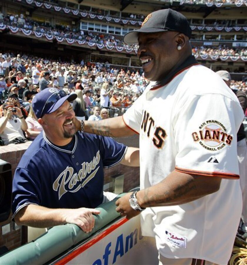 This April 3, 2007, file photo shows Padres pitcher David Wells greeting former Giants All-Star Kevin Mitchell.