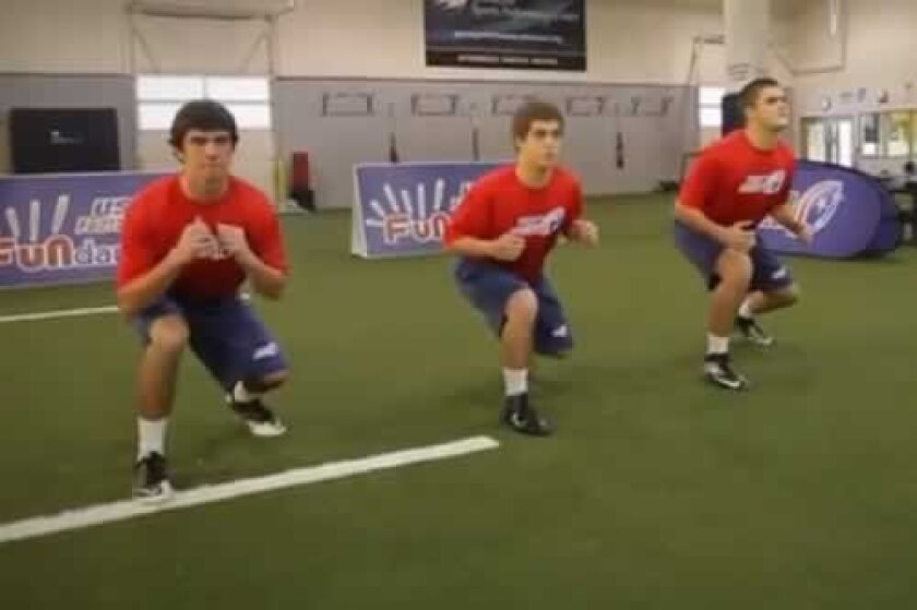 This screen grab from a training video demonstrates a 'hit' maneuver of Heads Up Tackle, which creates tension in the muscles as opposed to the joints, in preparing for a tackle. usafootball.com