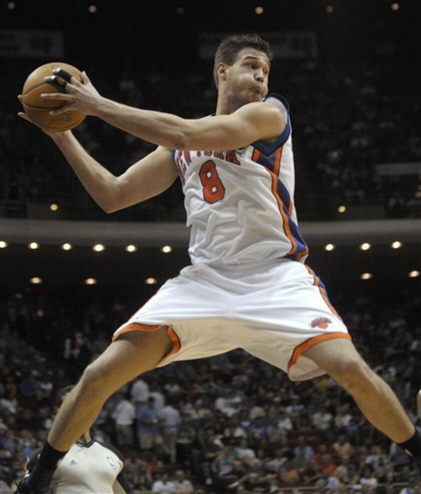New York Knicks forward Danilo Gallinari, of Italy, leaps while saving ball from going out of bounds during the first half of an NBA basketball game against the Orlando Magic in Orlando, Fla., Wednesday, Dec. 2, 2009. (AP Photo/Phelan M. Ebenhack)