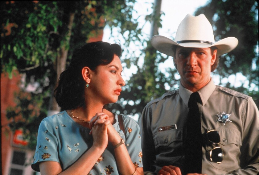 "Elizabeth Pena and Chris Cooper in ""Lone Star"""