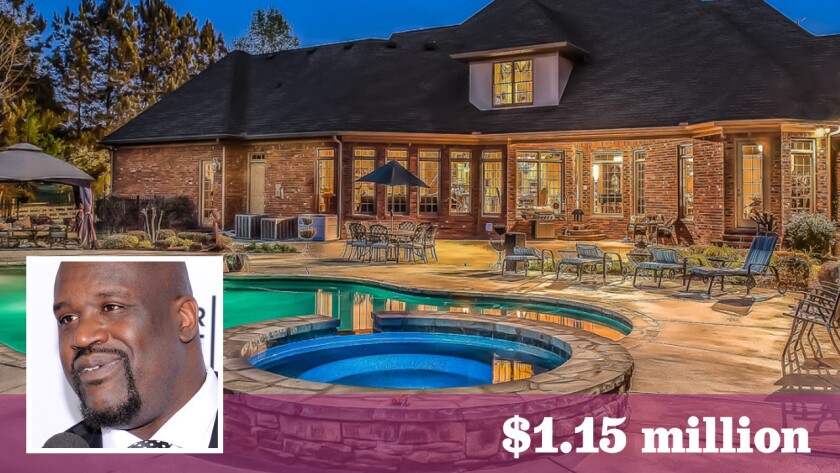 Former Laker Shaquille O'Neal has paid $1.15 million for a two-house estate in McDonough, Ga.