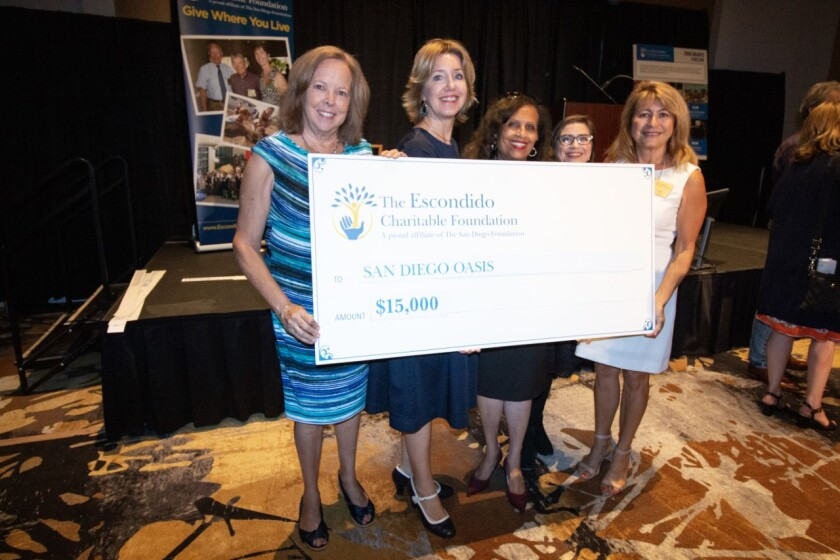 The Escondido Charitable Foundation, an affiliate of The San Diego Foundation, awarded $202,500 to seven nonprofit community programs at its 13th Annual Grants Celebration. The programs funded for the 2019-2020 grant cycle include Middle & High School Leadership Initiative with A Step Beyond; Northern Lights with California Center for the Arts Escondido; Field Renovations with Escondido American Little League; Grant Avenue Music Festival with Escondido Downtown Business Association; Dixon Lake Playground with Hidden Valley Kiwanis; Explore and Restore Felicita County Park with the Nature Collective and Intergenerational Literacy Tutoring Program with San Diego Oasis. Pictured are Escondido Charitable Foundation Board Members presenting San Diego Oasis staff members with a grant check during the recent Grants Celebration at the California Center for the Arts.