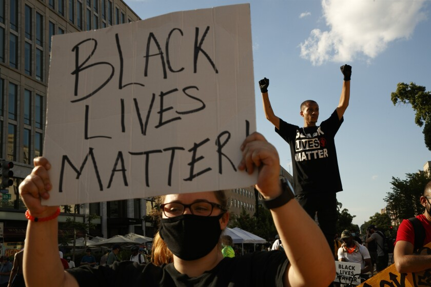 "Protester with ""Black Lives Matter"" sign"