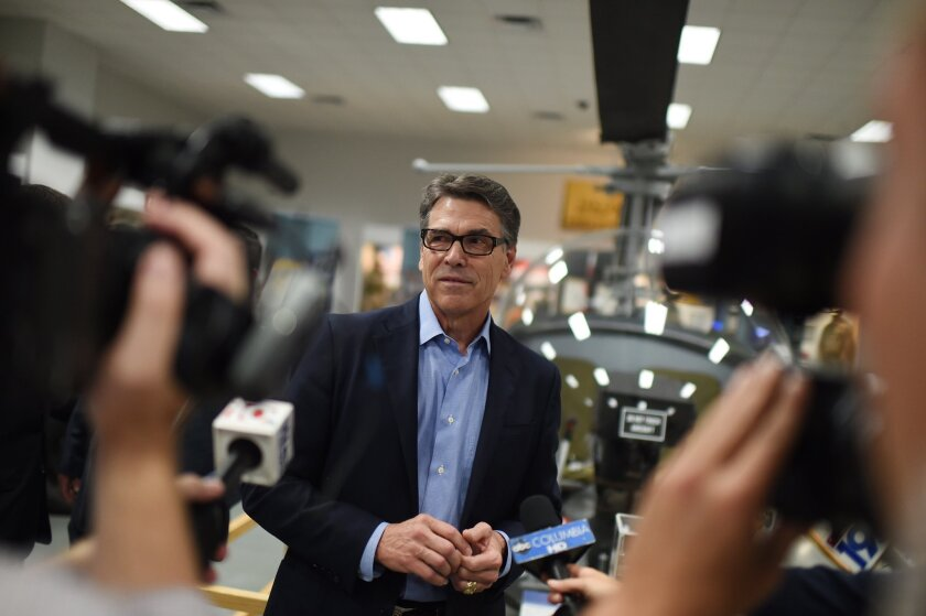 Republican presidential candidate and former Texas Gov. Rick Perry speaks to the media during a campaign stop at the South Carolina Military Museum on June 8 in Columbia, S.C.