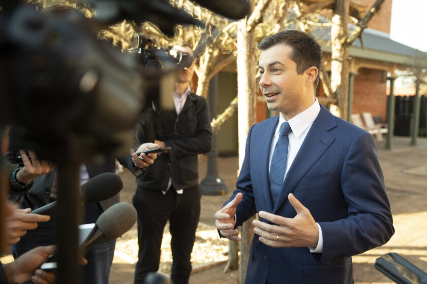 Democratic presidential candidate and former South Bend, Ind. Mayor Pete Buttigieg speaks with members of the media, Sunday, March 1, 2020, in Plains, Ga. (AP Photo/Matt Rourke)