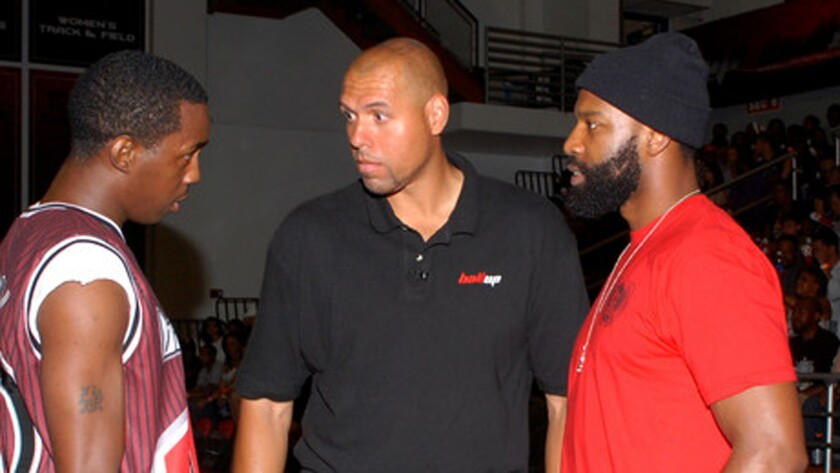 Tracy Murray, center, coaches an all-star team along with Baron Davis, right, during the Ball Up Championship Game at Cal State Northridge on June 24, 2011.