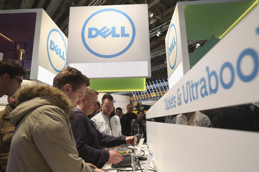 Visitors try out the latest laptop computers at the Dell stand at the 2013 CeBIT technology trade fair on March 5, 2013 in Hanover, Germany.Dell is going public again, as the company offers to exchange tracking stock for a new class of common shares in a $21.7B deal. The transaction is expected to close in the 4th quarter.