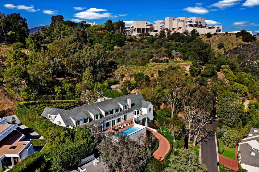 Sited below the Getty in Brentwood, the brick-clad residence was designed to evoke Denmark's traditional farmhouse architecture. Listed for $11.995 million, the Peter Chaote-designed house is reached by a winding drive that passes through a tunnel to reach the front motor court. The roughly two-third-acre property includes a greenhouse and a swimming pool. Expansive terraces center on views of the cityscape. The 7,958-square-foot house has a dual-island kitchen, a gym, four brick fireplaces, five bedrooms and 4.5 bathrooms.