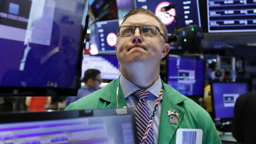 Trader Ryan Falvey works on the floor of the New York Stock Exchange.