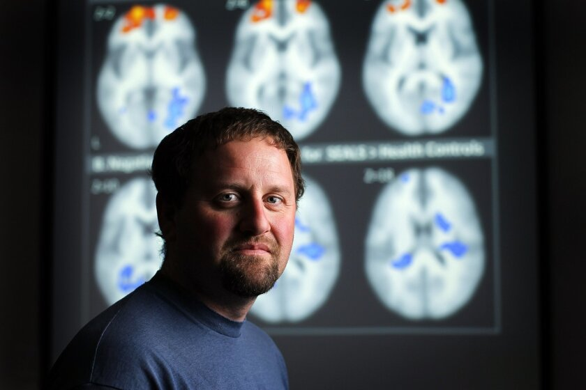 Alan N. Simmons, Ph.D. of the Veterans Affairs San Diego Healthcare System, co-authored a report about brain activity in Navy SEALs. The report sheds light on why military special operations forces perform well in extremely stressful situations. Simmons is shown here with brain studies from the report in La Jolla on Wednesday, March 7, 2012.