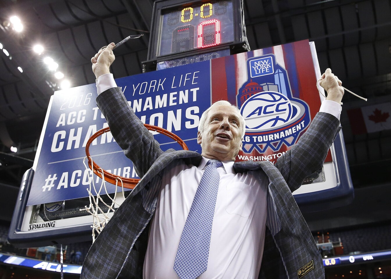 North Carolina Coach Roy Williams holds part of the net after his Tar Heels defeated Virginia in the ACC championship game on March 12.