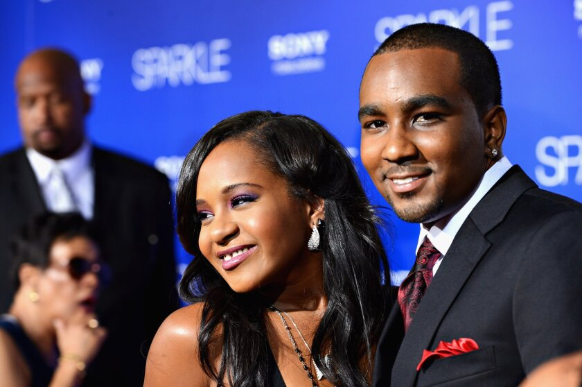 """Bobbi Kristina Houston Brown is pictured with Nick Gordon at the Aug. 16, 2012, premiere of """"Sparkle"""" at the Chinese Theatre in Hollywood."""