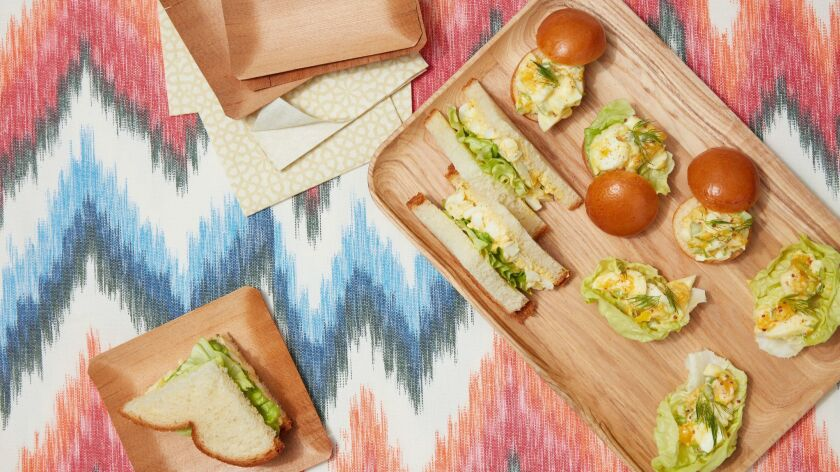 Tender, jammy egg yolks make for a silky egg salad, the ideal filling for soft white sandwich bread. Prop styling by Kate Parisian.